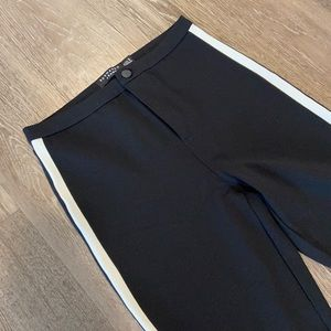 Black pants with white detail on the sides